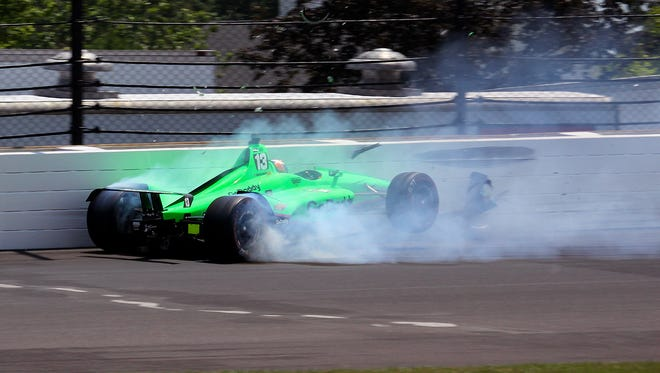Ed Carpenter Racing IndyCar driver Danica Patrick (13) hits the outside of turn two during the102nd running of the Indianapolis 500 at Indianapolis Motor Speedway on Sunday, May 27, 2018.