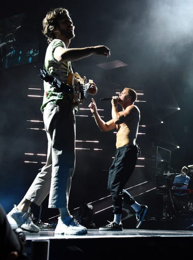Imagine Dragons Dan Reynolds (right) and Wayne Sermon perform at the Denny Sanford Premier Center in Sioux Falls, S.D. Tuesday, June 26, 2018.
