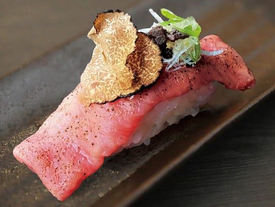 Aburi Sushi features Wagyu beef, truffle butter, tenkasu