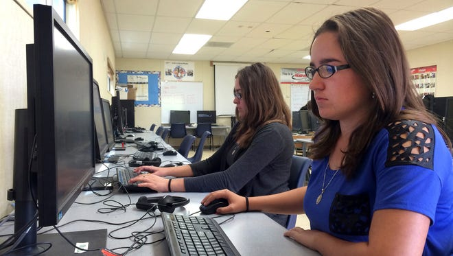 Students Leticia Fonseca,16, left, and her twin sister, Sylvia Fonseca, right, work in the computer lab at Cuyama Valley High School after taking the new Common Core-aligned standardized tests.
