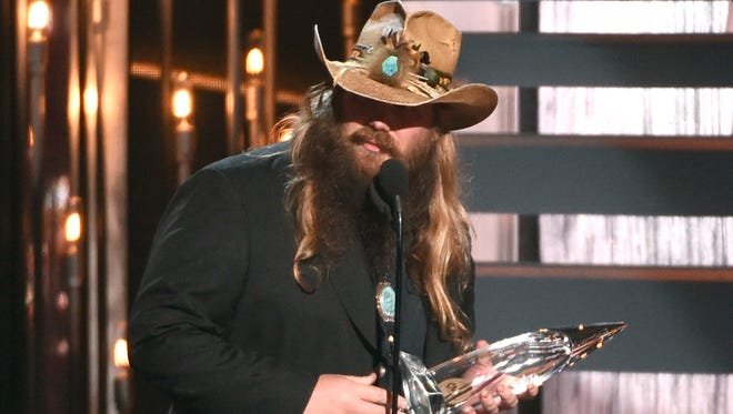 Chris Stapleton accepts the award for new artist of the year at the 49th annual CMA Awards at the Bridgestone Arena on Wednesday, Nov. 4, 2015, in Nashville, Tenn. (Photo by Chris Pizzello/Invision/AP)