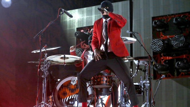 """Twenty One Pilots perform on their """"Emotional Roadshow"""" tour, Tuesday, July 26, 2016, at Talking Stick Resort Arena in Phoenix."""