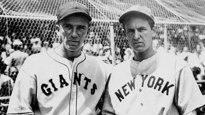"""Carl Hubbell of the Giants, left, and Vernon """"Lefty"""" Gomez of the Yankees, shown before they started the day for the All-Star teams in New York City on July 10, 1934."""