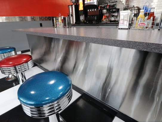 A counter and classic spinning stools are part of the
