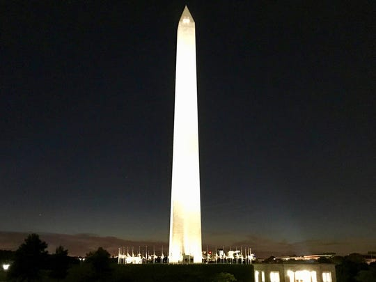 In a most miraculous way as the angry sky settled into darkness and stillness, I found myself standing in the brilliant, reflected light of the Washington Monument.