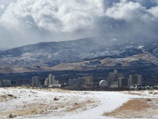 Fresh snow and storm clouds are seen in Reno on a snowy