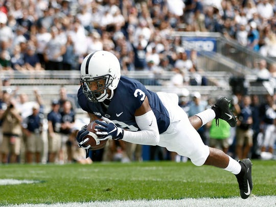 Penn State's DeAndre Thompkins (3) catches a touchdown pass against Kent State during the first half of an NCAA college football game in State College, Pa., Saturday, Sept. 15, 2018. (AP Photo/Chris Knight)