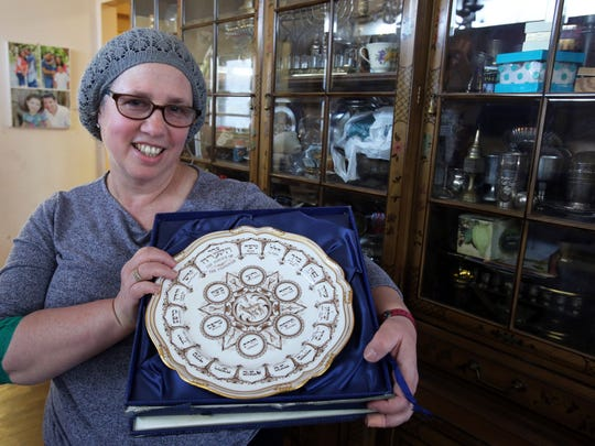 Eileen Grossman holds her Passover Seder plate from