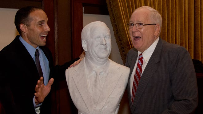 Sculptor Ben Victor surprises Kenneth Quinn, the World Food Prize president, with a marble bust Victor sculpted.