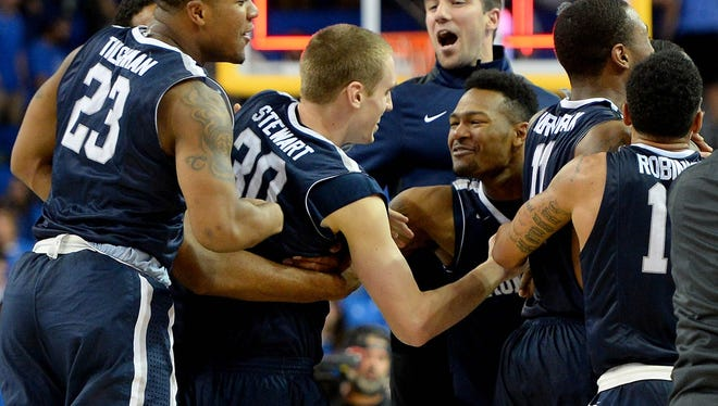 Monmouth University celebrates its 84-81 overtime win at UCLA on Friday night
