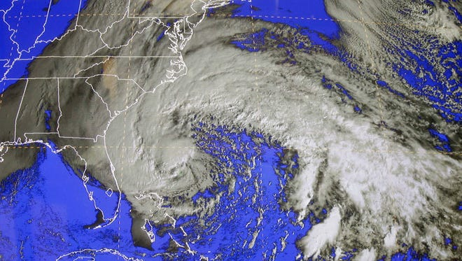 A satellite image of Sandy is shown at the National Hurricane Center in Miami, Saturday, Oct. 27, 2012. Early Saturday, the storm was about 335 miles southeast of Charleston, S.C. Tropical storm warnings were issued for parts of Florida's East Coast, along with parts of coastal North and South Carolina and the Bahamas. Tropical storm watches were issued for coastal Georgia and parts of South Carolina, along with parts of Florida and Bermuda. Sandy is projected to hit the Atlantic Coast early Tuesday.
