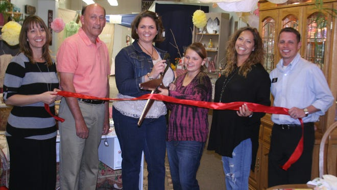 The Yerington Chamber of Commerce held a ribbon-cutting Thursday for Sierra's Shabby Chic & Garden Decor, which opened recently on Main Street in Yerington. Pictured are, from left, Shelly Fowler, Chamber director, Yerington Mayor George Dini, business owner Jenifer Haase, her daughter Lea, Chamber vice president Shaline Montgomery and Chamber director Jerry Bryant.