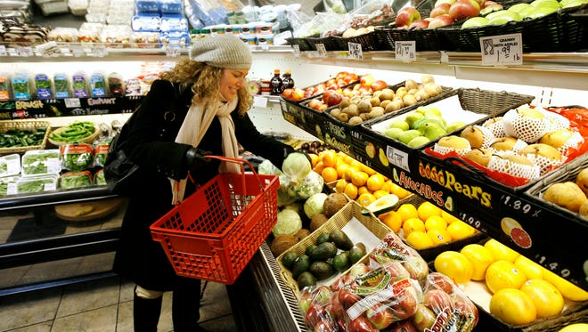 Emily Whipple of Boston selects her produce at the Golden Goose Market in Boston, Feb. 20, 2008.