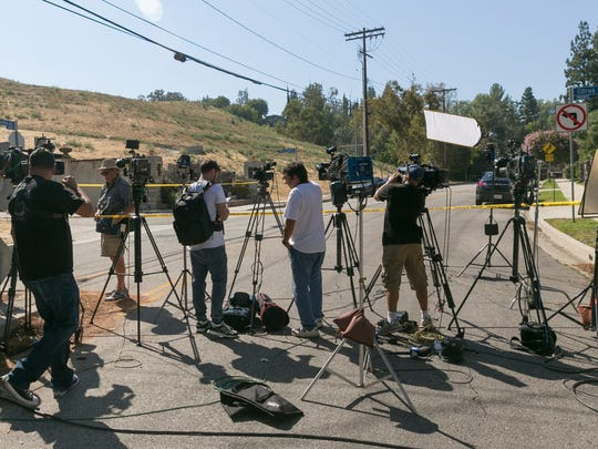 The media wait outside Chris Brown's house.