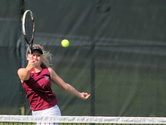 Jaiden Tweed returns a volley against East Henderson on Aug. 22 at Owen in a match she won in consecutive 6-0 sets.