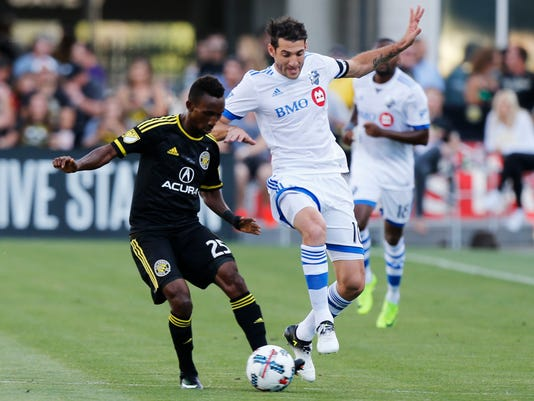 Columbus Crew's Harrison Afful, left, and Montreal Impact's Ignacio Piatti vies for the ball during the first half of an MLS soccer match Saturday, June 24, 2017, in Columbus, Ohio. (AP Photo/Jay LaPrete)