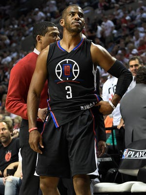 Chris Paul (3) of the Los Angeles Clippers walks off the court after he injured his hand.