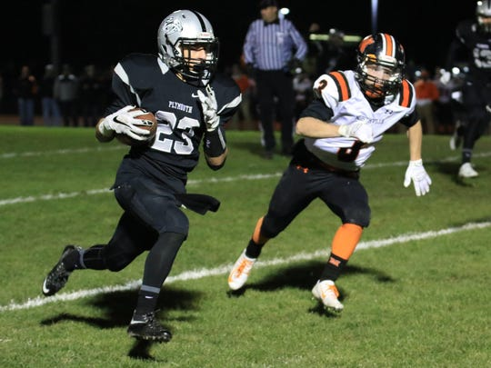 Plymouth's Isaac Emminger (No. 23) is off to the races on his 51-yard touchdown run in the third quarter, which evened the contest at 13-13. Trying to catch Emminger is Northville's Zachary Prystash (No. 3).