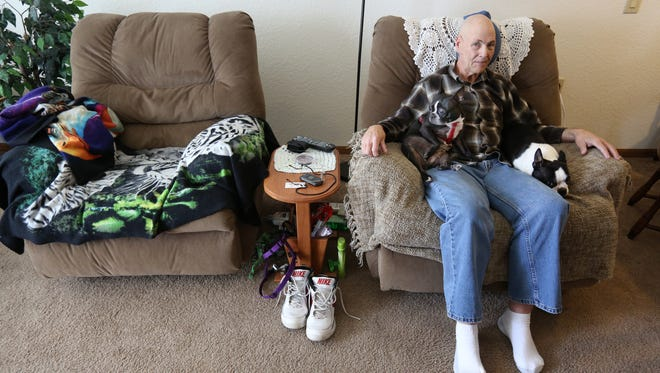 Texie Ingram, a widower from Blanchester, Ohio, sits with his two dogs inside of his apartment. Ingram was recently denied the Meals on Wheels service.