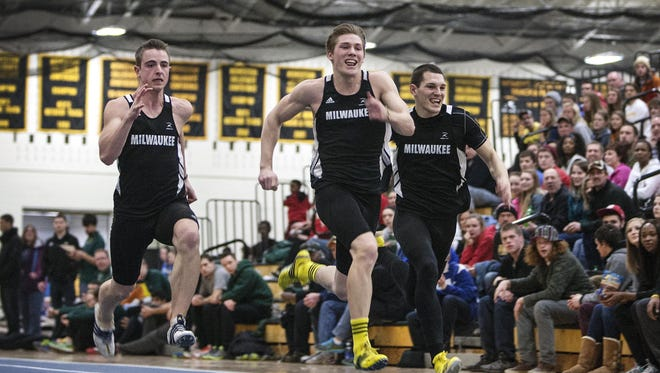 Brothers Nate Pozolinski (center) and Brett Pozolinski (right) compete against each other during a 60-meter dash event for the Milwaukee Panthers. The brothers have both qualified for the NCAA Track and Field Championships.