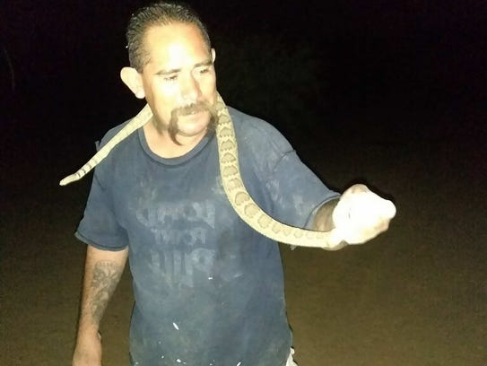 Victor Pratt caught the rattlesnake and posed for several