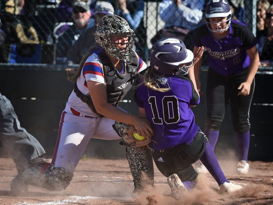 Reno catcher Dominique Harding tags Spanish Springs' Kilee Pender during a regional playoff game at Bishop Manogue high on Friday.