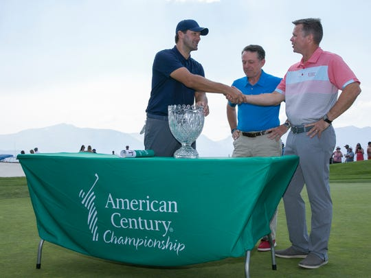 Tony Romo shakes hands with American Century CEO Johathan Thomas after winning the American Century Championship at Edgewood Tahoe Golf Course in Stateline on Sunday.