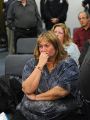Donna Canzoneri cries as the thought of her and her boyfriend losing their home weighs heavily on her mind.