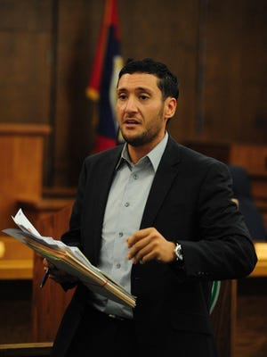 Attorney Tarek M. Baydoun represents the families who have issues with their homes being sold for not paying taxes on time. He speaks at Monday's swearing in session.