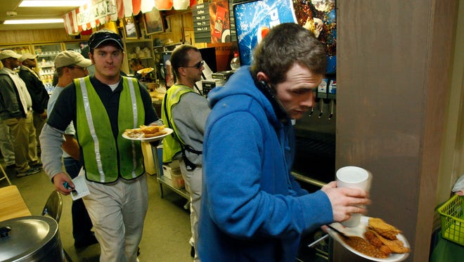 Workers at a Toyota manufacturing plant in Blue Springs, Miss., crowd a lunch counter in 2011. The plant provides needed high-tech and skilled labor employment to area residents.