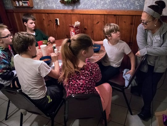 Brenda Nichols, 59, has raised five of her grandchildren, now ages 8 through 15. Unemployed, Nichols relied on the state's Kinship Care program to help ease the financial burden.