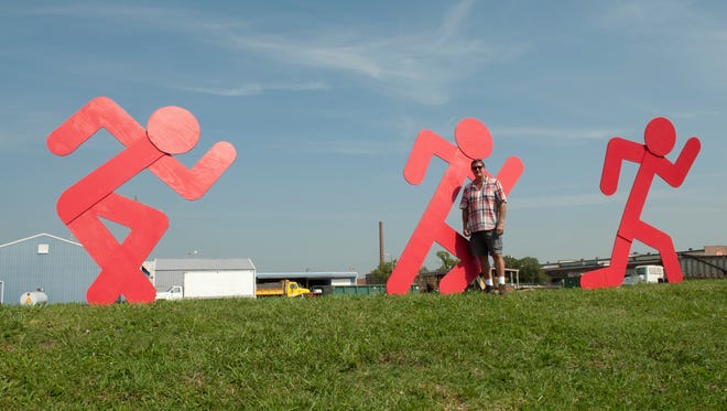 Artist Michael Wimmer with a version of the sculpture that Jeffersonville has chosen to install as its first large scale public art commission in its City Canvas public art program.