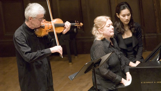 A file photo of Oleh Krysa, left, and Tatiana Tchekina, center, at the Kilbourn Hall in Rochester in 2008.