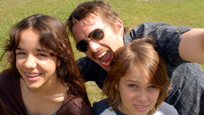 Samantha (Lorelei Linklater), Mason Sr. (Ethan Hawke) and Mason at age 9 (Ellar Coltrane) in 'Boyhood.'