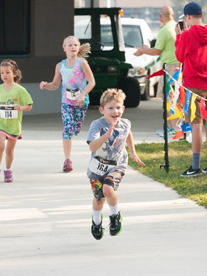 Kids race to the finish line Saturday morning.