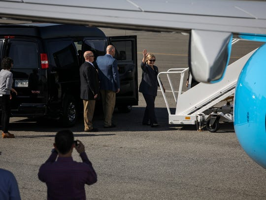 Hillary Clinton boards her campaign plane for a flight
