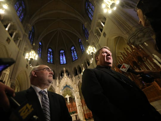 Cardinal-elect Joseph Tobin will become the sixth Archbishop of Newark.  Here, he addresses the press after the announcement was made at the Cathedral Basilica of the Sacred Heart (Newark Archdiocese Director of Communications Jim Goodness is shown on the left) on Monday, Nov. 7, 2016.