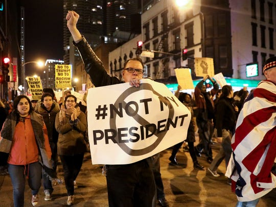 Protesters march North on State Street to express their disapproval of the election of Donald Trump as the 45th president of the United States, Wednesday, Nov. 9, 2016 in Chicago.