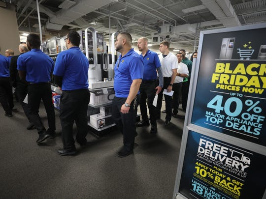More than 100 Best Buy employees lining up at a check-out