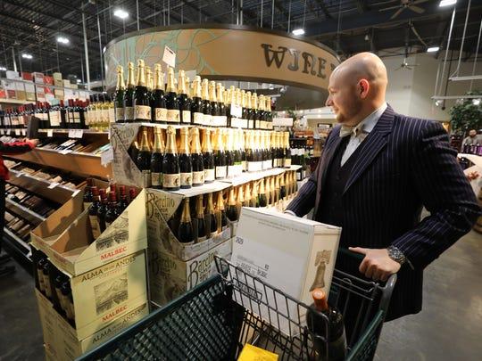 Bryan Dunst of Kinnelon shopping on Friday for wine