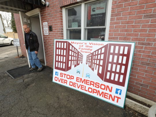 A sign outside Academy Electric in Emerson, opposing redevelopment plans.