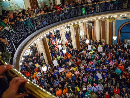 Demonstrators gather in the rotunda Monday, Feb. 13,