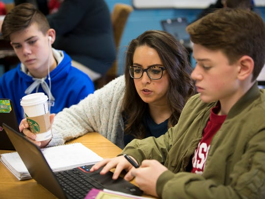 Mon., Jan. 30, 2017: Math teacher Kirby Harshbarger goes over work with eighth-grade students Spencer Couzins, left, and Rowan Brauer at Conner Middle School in Hebron.