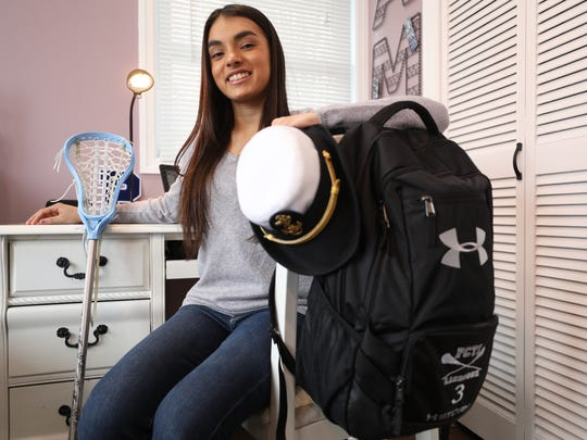Ashley Mangarella, with her ROTC hat and backpack, is a member of the Passaic County Technical Institute lacrosse team.
