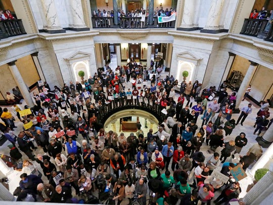 In this file photo taken at the Capitol during the 2017 session, advocates for public schools rally against legislative leaders' plans to rewrite the state's school funding formula.