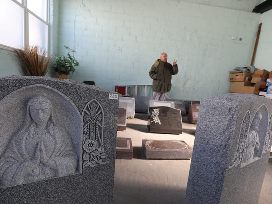 Thomas Goffredo in the showroom which used to be the company's manufacturing facility.  The headstones are now designed and ordered at the North Arlington location but manufactured off-site.