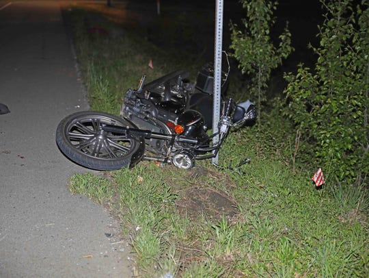 Two motorcyclists were injured in a crash with a vehicle