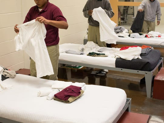 Juveniles fold laundry next to their beds on Wednesday, April 26. 2017 at the Nueces County Robert N. Barnes Regional Juvenile Facility.