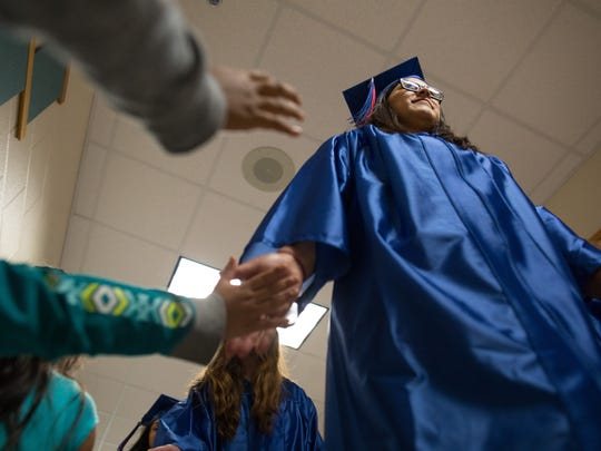 Gregory-Portland High School seniors wearing caps and gowns on Tuesday, May 23, 2017, walk the hallways of Stephen F. Austin Elementary School in Gregory for the district's 2017 senior walk.