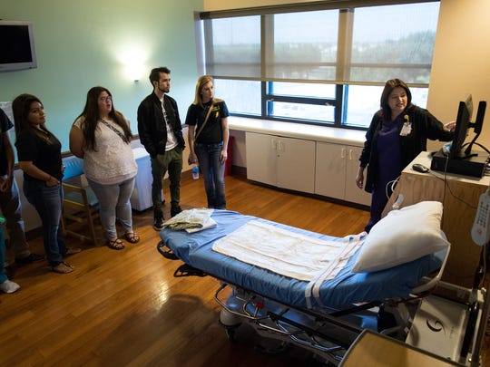 Nurse Eva Torrez shows a group of Branch Academy for Career and Technical Education seniors one of Christus Spohn Hospital South's maternity rooms on Thursday, May 25, 2017.